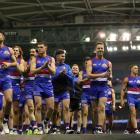 AFL's Western Bulldogs are isolating until they return negative Covid-19 tests, the team said,...