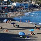 People cool on a beach in Benalmadena, southern Spain, earlier this month. Photo: Reuters