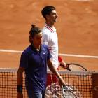 Lorenzo Musetti (L) and Novak Djokovic walk off the court after Musetti retired injured. Photo:...