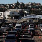 Vehicles wait in line at the Bondi Beach drive-through Covid-19 testing centre in Sydney as...