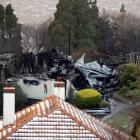 The remains of the clubhouse at Belleknowes Golf Club this morning after last night's blaze....