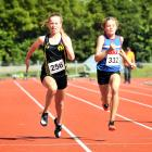 Mt Aspiring's Estelle Gellatly (13) narrowly beats Queen's High School pupil Jorja Gibbons (13) in an under-14 girls 100m race.