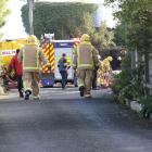 Firefighters at the scene of the house fire in Balclutha today. Photo: John Cosgrove