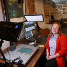 New Clutha Libraries community heritage co-ordinator Tiffany Jenks digitally archives a vintage...