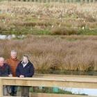Standing overlooking the new Waipahi Wetland are (from left) project manager Shane Bocock, and...