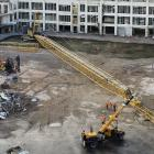 The boom of a large crane nicknamed ''Stretch'', which is being assembled at the site of the new...