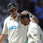 Tim Southee congratulates Devon Conway for reaching a double century after the innings Action...
