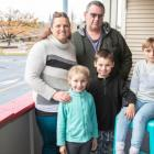 The Williams family are overjoyed that they were able to evade the flood waters safely. Photo:...