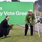 Green MP Eugenie Sage helps set up a sign for the party's Taieri candidate, Scott Willis, during...