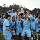 South City Royals captain Jared Grove holds the ODT Southern Premiership Trophy as he and team...