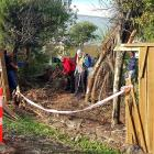 The fence of the Mt Pleasant community garden collapsed after a car crashed through it. Photo:...