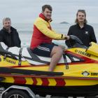 Surf Life Saving New Zealand Otago operations committee chairman Cameron Burrow, on jet ski, and ...