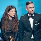 Singer Lorde and songwriter Joel Little accept the Best Pop Solo Performance award for 'Royals'...