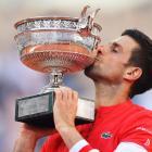 Novak Djokovic celebrates with the French Open trophy. Photo: Reuters