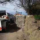 Dooleys Masonry has started deconstructing the old stone archway at Awamoa Park. The two pillars...