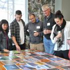 Judging the Otago Museum Photography Competition yesterday are (from left) Shanaya Cunningham, of...