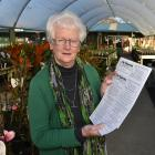 Pat Macaulay holds a copy of The Taieri Pet, a newsletter produced by the Middlemarch branch of...