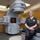 Retiring Dunedin Hospital radiation therapist Gaynor Chronican with a tool of her trade, a...