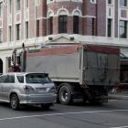 Vehicles drive through the intersection of Stuart and Cumberland Sts despite the traffic lights...