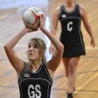 Southern Magpies goal shoot Hannah Riddle-Pelchen, watched by team-mate Sara McCarthy, prepares...