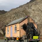 The Gratuity Cottage enters the Nevis Bluff area as it is transported to its new home in St...