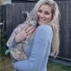 QT Community Cats trustee secretary Mel Gold with a friend. Photo: Scene