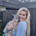 QT Community Cats trustee secretary Mel Gold with a friend. PHOTO: GUY WILLIAMS