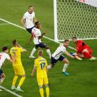 England's Jordan Henderson celebrates scoring their fourth goal against Ukraine. Photo: Pool via...