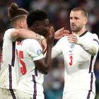 England's Bukayo Saka look dejected after losing the penalty shootout as Luke Shaw and Kalvin...