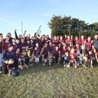 Members of the winning Clutha Valley team invited their children in for a celebratory photo after...