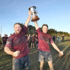 Clutha Valley co-captains Reid Benge (left) and Jordy Willocks hold up the Speight's Cup after...