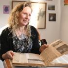 Author Becky Manawatu flicks through her nana's scrapbook.  PHOTOS: LINDA ROBERTSON