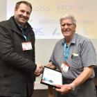 IT Professionals New Zealand national president Anthony Dowling presents Bruce McMillan with an...