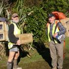 South Otago Forest & Bird volunteers Roy Johnstone (left) and Jim Young prepare to lay...