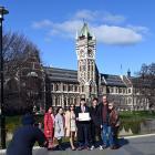 Student Apisit Uthakhamkong takes photos of University of Otago BSc graduand Tane Murphy and his...