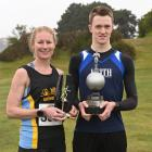 Otago cross-country winners Margie Campbell and Janus Staufenberg with the spoils of victory at...