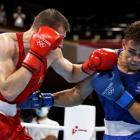 Uladzislau Smiahlikau (red) of Team Belarus exchanges punches with David Nyika who won the...