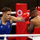 Youness Baalla (red) of Morocco defends as Kiwi Olympian David Nyika throws a punch. Photo: Getty...