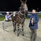 Waikouaiti trainer Amber Hoffman with driver Sarah O'Reilly and Dodgethebullet, who won the final...