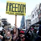 Participants march down George St in Sydney during an anti-lockdown protest on Saturday. Photo:...