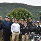 The two teams representing the Otago Golf Club, the B52s and the Bombers, watch as Callum Judkins...