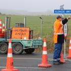 McDonough Contracting staff block off the road between Te Tipua and Mataura. Photo: Sandy Eggleston