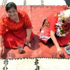 Applying motifs yesterday to a Tongan tapa cloth, for one of many cultural presentations at the...