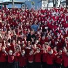 Surrounded by the pupils and staff of Mornington School in Dunedin is its new school principal,...