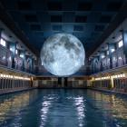 Museum of the Moon hovers over the main pool at St George's Swimming Pool, in Rennes, France. ...