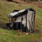 The public toilet in rural Southland's Cosy Nook cove was burned down. Photo: Supplied