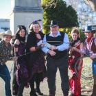 Encouraging Waimate District Council chief executive Stuart Duncan (centre) to buy a ticket for...