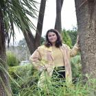 Forest fascination . . . Science communication masters student Olivia Taylor-Peebles, examining...