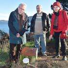 Back Beach Writers members (from left) John Holmes, Robert Free, and Anna Holmes are saddened by...