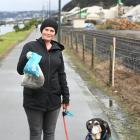 Jen South, of Port Chalmers, joins the effort to scoop the poop along the West ...
